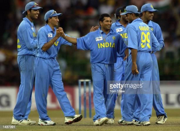 Sachin Tendulkar of India is congratulated by teammates after taking the wicket of Mahela Jayawardene of Sri Lanka during the India v Sri Lanka Final...