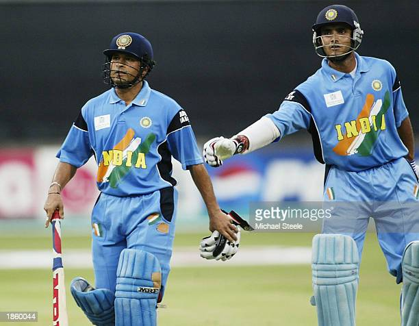 Sachin Tendulkar of India is given a pat on the back by his captain Sourav Ganguly after being dismissed for 83 during the ICC Cricket World Cup Semi...