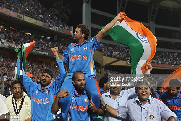 Sachin Tendulkar of India is lifted by his team mates on a lap of honour after their six wicket victory during the 2011 ICC World Cup Final between...