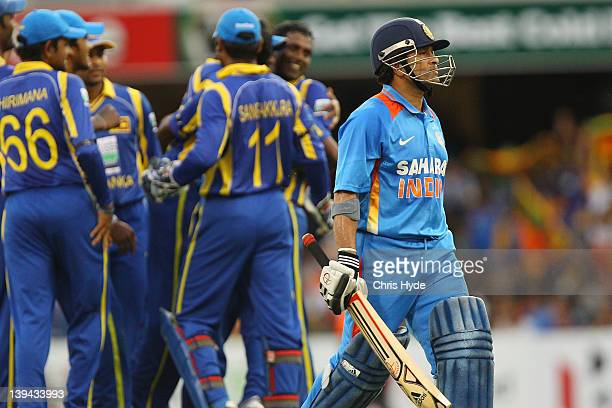 Sachin Tendulkar of India leaves the field after being bowled out by Nuwan Kulasekara of Sri Lanka during game eight of the One Day International...