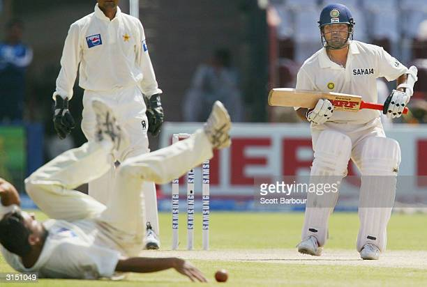 Sachin Tendulkar of India looks for a run as Pakistani bowler Saqlain Mushtaq attempts to stop the ball during day 2 of the 1st Test Match between...