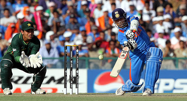 Sachin Tendulkar of India plays a shot during the 2011 ICC World Cup semifinal match between India and Pakistan at PCA Stadium in Mohali India on...