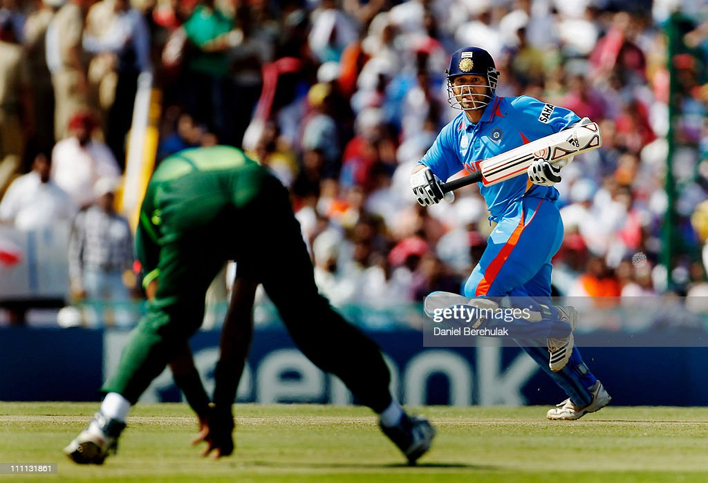 Sachin Tendulkar of India runs between wickets during the 2011 ICC World Cup second SemiFinal between India and Pakistan at Punjab Cricket...