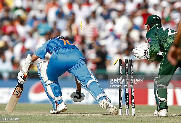 Sachin Tendulkar of India survives a close stumping chance after wicketkeeper Kamran Akmal of Pakistan took the bails off during the 2011 ICC World...
