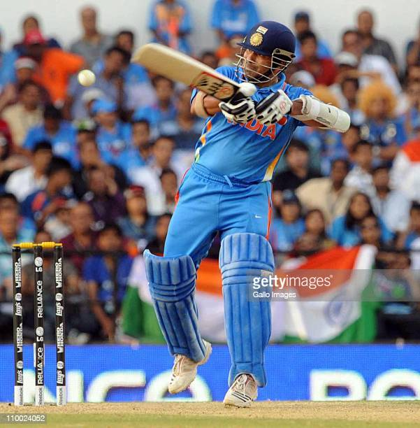 Sachin Tendulkar of India swings during the Group B ICC World Cup Cricket match between India and South Africa at Vidarbha Cricket Association Ground...