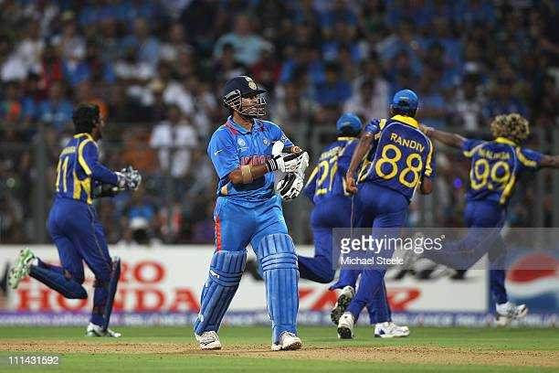 Sachin Tendulkar of India walks after being dismissed off the bowling of Lasith Malinga during the 2011 ICC World Cup Final between India and Sri...