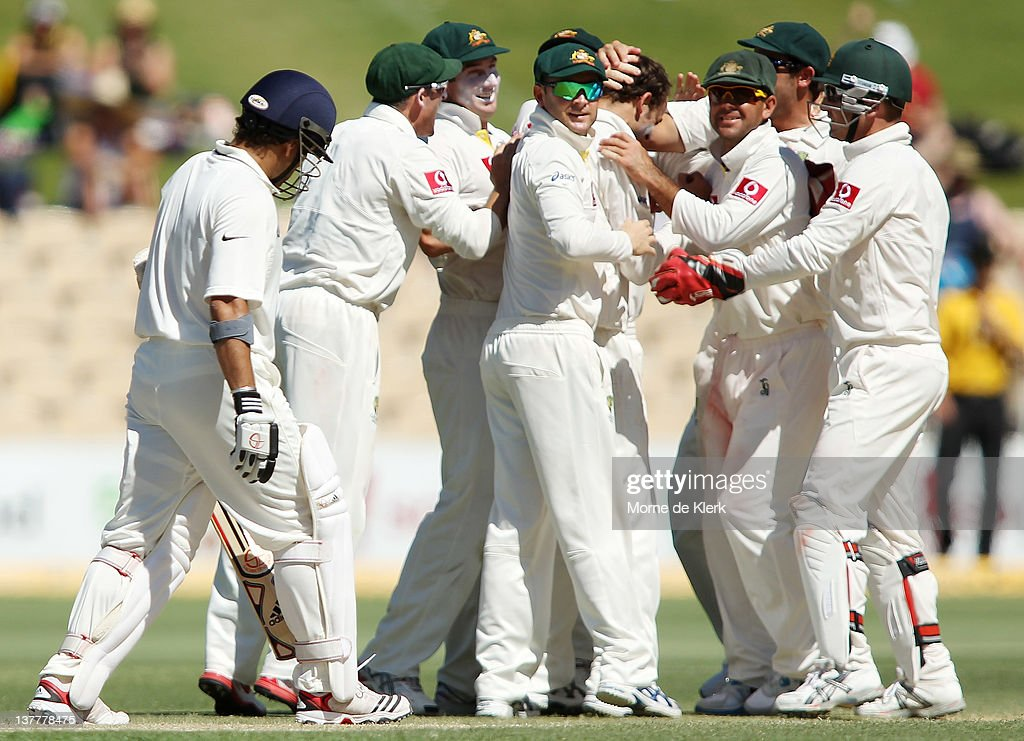 Sachin Tendulkar (L) of India walks off after getting out as Australian players congratulate bowler Nathan Lyon for getting him out during day four of the Fourth Test Match between Australia and India at Adelaide Oval on January 27, 2012 in Adelaide, Australia.