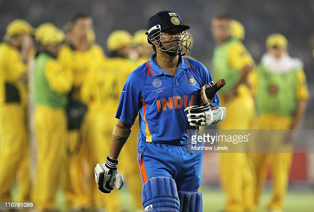 Sachin Tendulkar of India walks off after he was caught by Brad Haddin of Australia off the bowling of Shaun Tait during the 2011 ICC World Cup...
