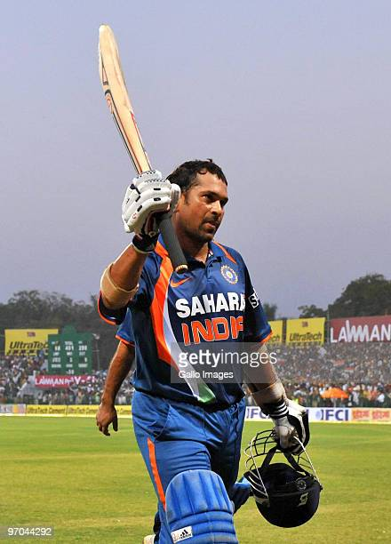 Sachin Tendulkar of India walks off the field and acknowledges the crowd as the first player in history to reach a double century in a one day...