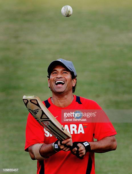Sachin Tendulkar of India warms up during the Indian team training session at Feroz Shah Kotla Stadium on March 8 2011 in Delhi India