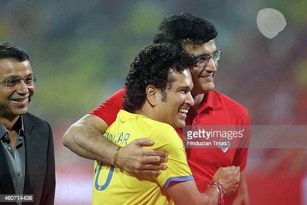 Sachin Tendulkar of Mumbai City FC and Sourav Ganguly of Atletico De Kolkata during a closing ceremony of Indian Super League football tournament...