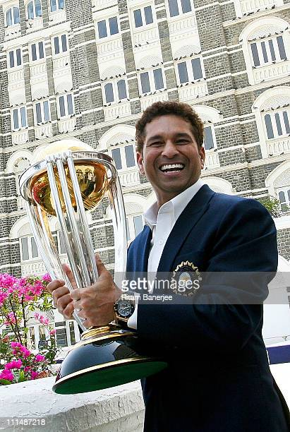 Sachin Tendulkar of the Indian cricket team poses with the ICC Cricket World Cup Trophy during a photo call at the Taj Palace Hotel on April 3 2011...