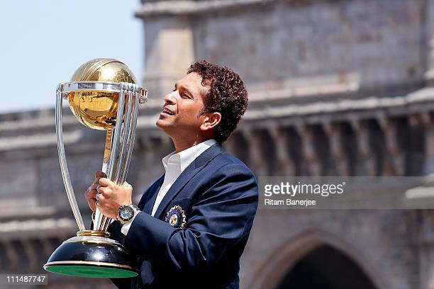 Sachin Tendulkar of the Indian cricket team poses with the ICC Cricket World Cup Trophy with the Gateway of India in the backdrop during a photo call...