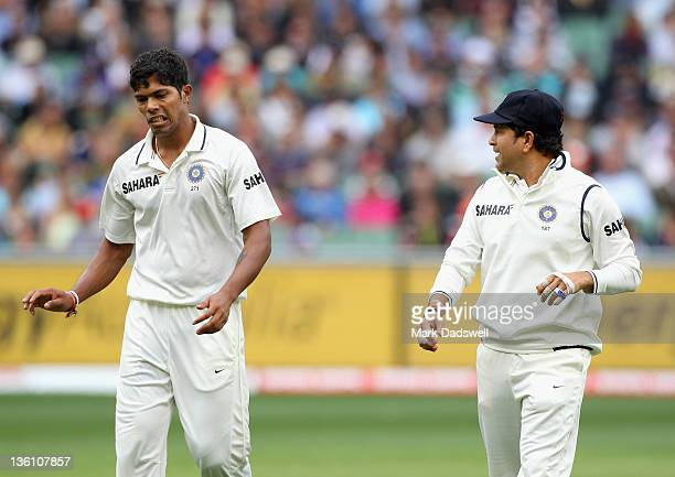 Sachin Tendulkar offers advice to Umesh Yadav of India during day one of the First Test match between Australia and India at Melbourne Cricket Ground...
