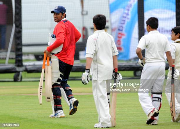Sachin Tendulkar's son Arjun Tendulkar 9 shares a laugh with India's captain MS Dhoni a practice session at Lord's Cricket Ground London