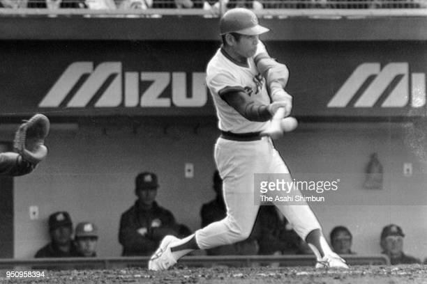 Sachio Kinugasa of Hiroshima Toyo Carp at bat at his retirement game against Yakult Swallows at Hiroshima City Stadium on March 27 1988 in Hiroshima...