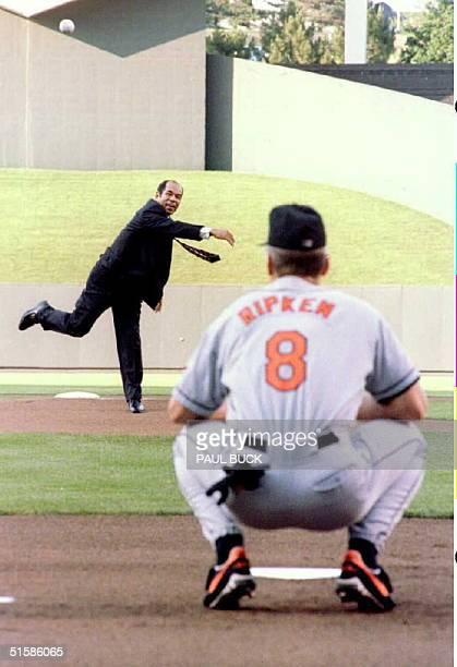 Sachio Kinugasa of Japan throws out the ceremonial first pitch to Cal Ripken Jr prior to the OriolesRoyals game at Kauffman Stadium in Kansas City...