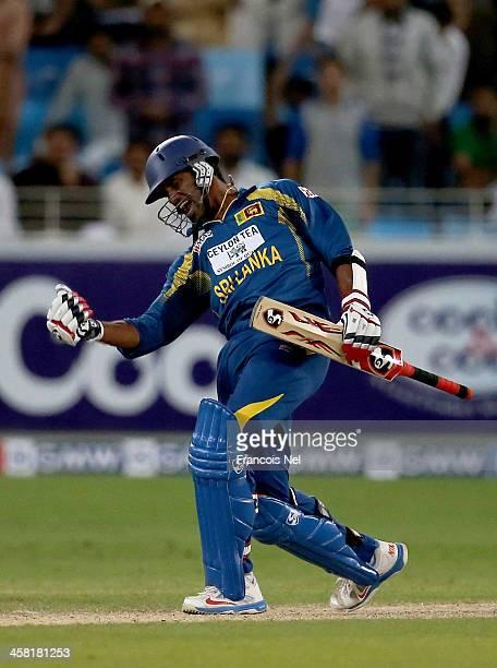 Sachithra Senanayaka of Sri Lanka celebrates after hitting the winning runs to win the second OneDay International match between Sri Lanka and...
