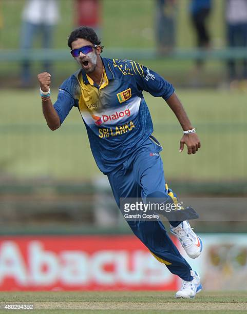 Sachithra Senanayake of Sri Lanka celebrates dismissing England captain Alastair Cook during the 5th One Day International between Sri Lanka and...