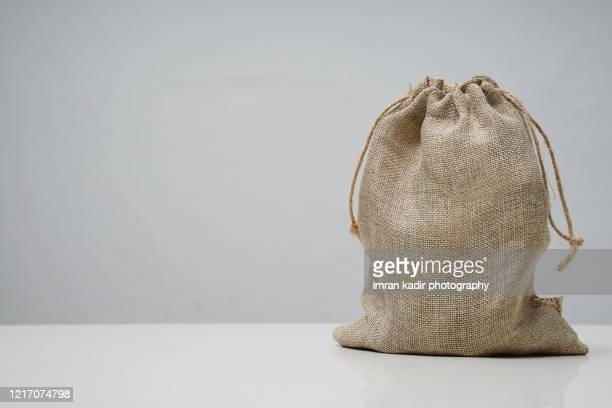 sack on table with copy space - economic stimulus stock pictures, royalty-free photos & images