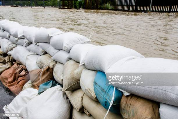 sacks at waterfront - flooding stock photos and pictures