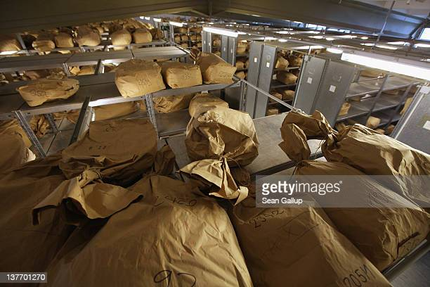 Sacks containing the torn remains of documents that once belonged to the former East German secret police the Stasi lie stored in a warehouse at a...