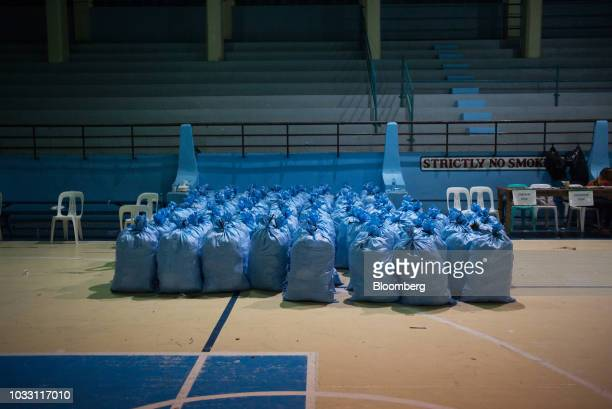 Sacks filled with relief goods sit in a gym awaiting distribution to temporary evacuation centers ahead of Typhoon Mangkhut's arrival in Tuguegarao...
