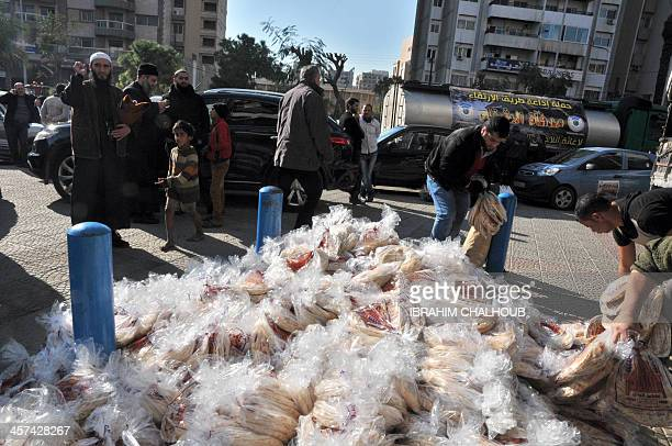 Sacks of bread and other relief material are prepared ready for transportation to Syrian refugees encamped in Arsal in the Lebanese Bekaa valley on...