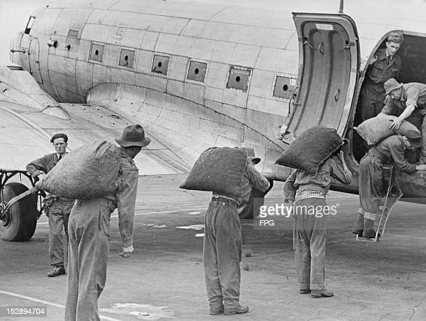 Sacks of coal are loaded onto an aircraft at the Fassberg Air Base Fassberg for transport to Berlin during the Berlin Airlift 1948 The airlift was...