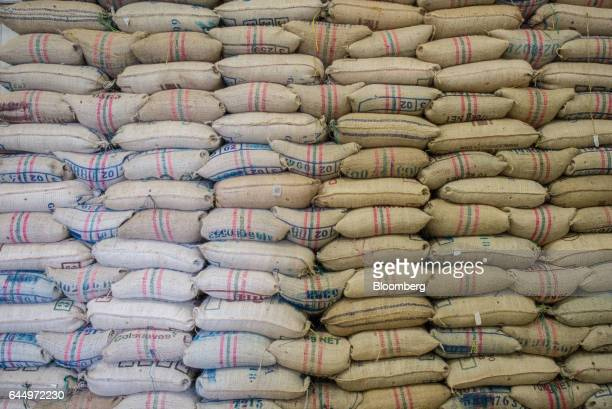 Sacks of coffee beans packaged for export sit at the Cafexcoop plant in the town of Sevilla department of Valle del Cauca Colombia on Tuesday Jan 31...