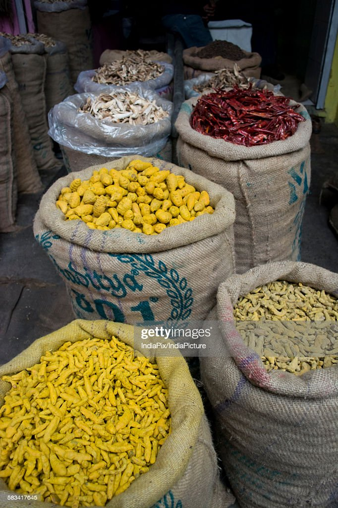 Sacks of dried chillies and turmeric root for sale at the market : Stock Photo
