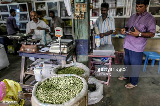 Sacks of green cardamom sit on display at a wholesale spice store in Cochin Kerala India on Friday May 29 2015 While consumerprice gains eased to a...