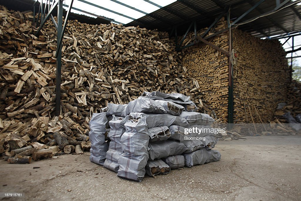 Sacks of logs used for firewood sit for sale in a wood yard