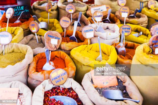 sacks of multicolored spices on market - corsica stock-fotos und bilder