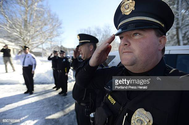 Saco Police Officers including Kyle Moody salute Police Chief Brad Paul after Paul was escorted home after his last day on the job with the Saco...