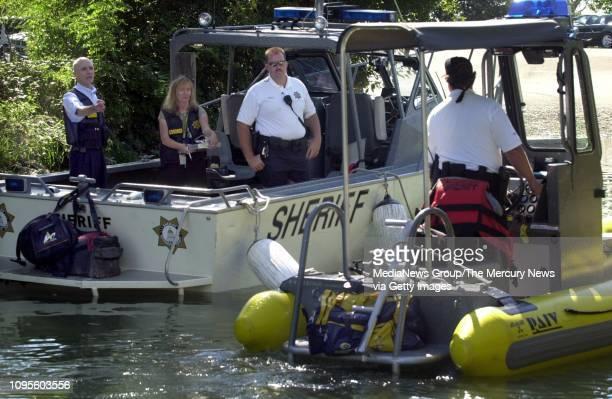 Sacramento County Coroner Paul Smith deputy coroner Brianna Pierce and Sacramento County sheriff's deputy Don Hyatt stand on a sheriff's boat with...