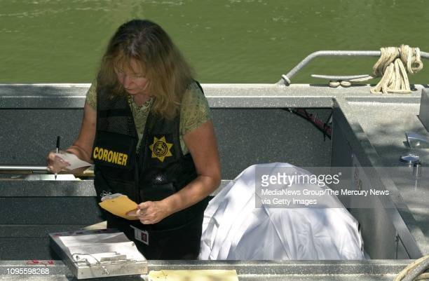 Sacramento County deputy coroner Brianna Pierce works as the search for duffel bags containing body parts continues in the Mokulmne River near...
