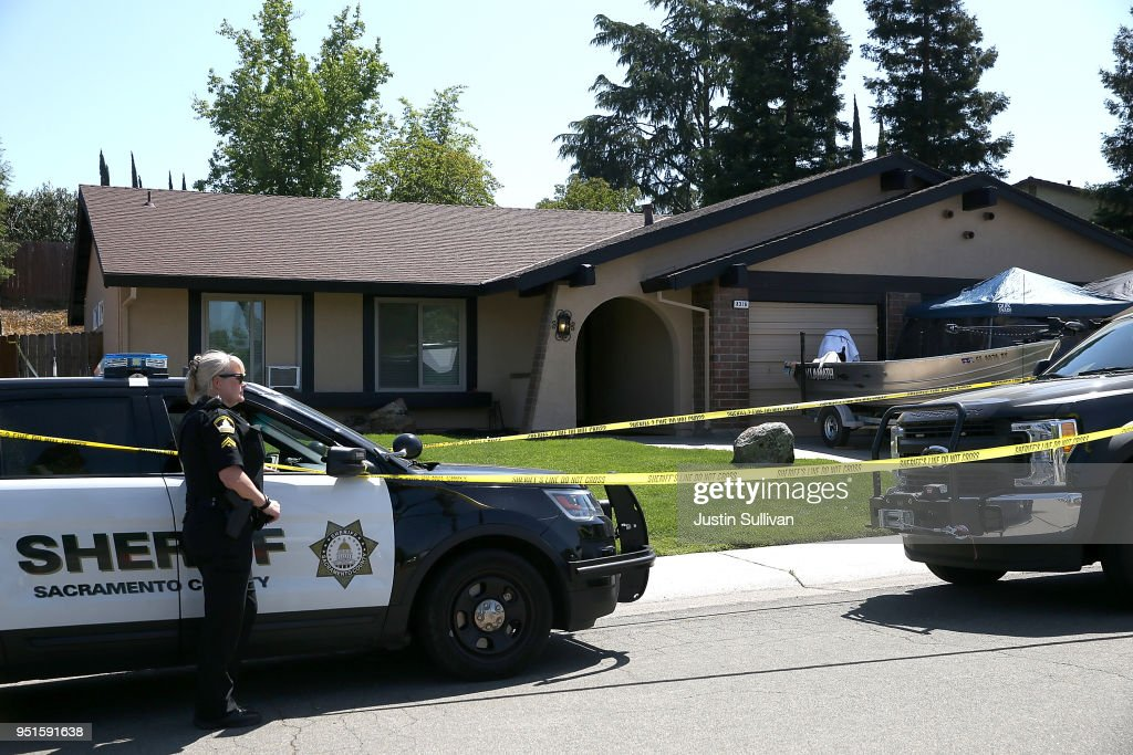 A Sacramento County sheriff deputy stands guard in front of the home of accused rapist and killer Joseph James DeAngelo on April 24, 2018 in Citrus Heights, California. Sacramento District Attorney Anne Marie Schubert was joined by law enforcement officials from across California to announce the arrest of 72 year-old Joseph James DeAngelo who is believed to be the the East Area Rapist, also known as the Golden State Killer, who killed at least 12, raped over 45 people and burglarized hundreds of homes throughout California in the 1970s and 1980s.