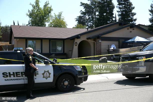 Sacramento County sheriff deputy stands guard in front of the home of accused rapist and killer Joseph James DeAngelo on April 24 2018 in Citrus...
