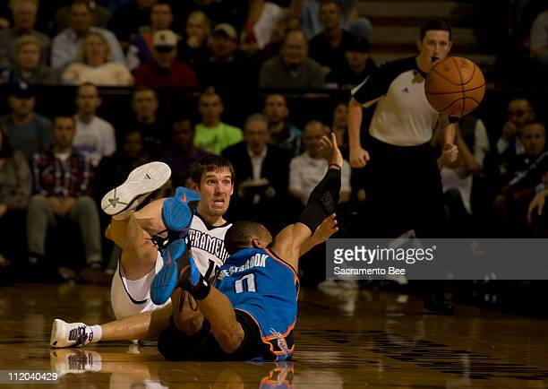 Sacramento Kings 'Beno Udrih out hustles Oklahoma Thunder's Russell Westbrook for a loose ball in the second quarter at Power Balance Pavilion in...
