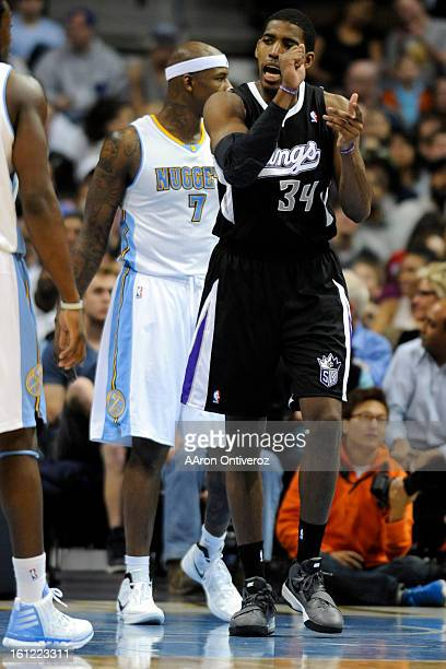 Sacramento Kings center Jason Thompson looks for a foul call on Denver Nuggets power forward Al Harrington during the second half of the Nuggets'...