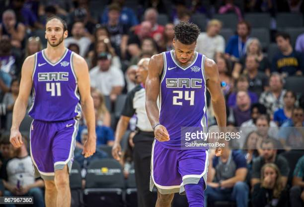 Sacramento Kings center Kosta Koufos and teammate Sacramento Kings guard Buddy Hield walk off the court as their team trailed against the Washington...