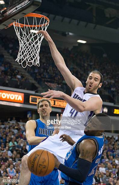 Sacramento Kings center Kosta Koufos goes high for an alleyoop but the ball is knocked away by Dallas Mavericks guard Wesley Matthews on Sunday March...