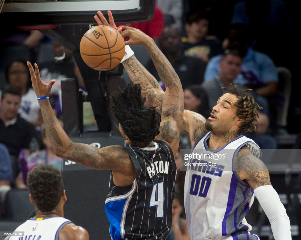 Sacramento Kings center Willie Cauley-Stein (00) blocks a shot by Orlando Magic guard Elfrid Payton (4) on Monday, March 13, 2017 at Golden 1 Center in Sacramento, Calif.