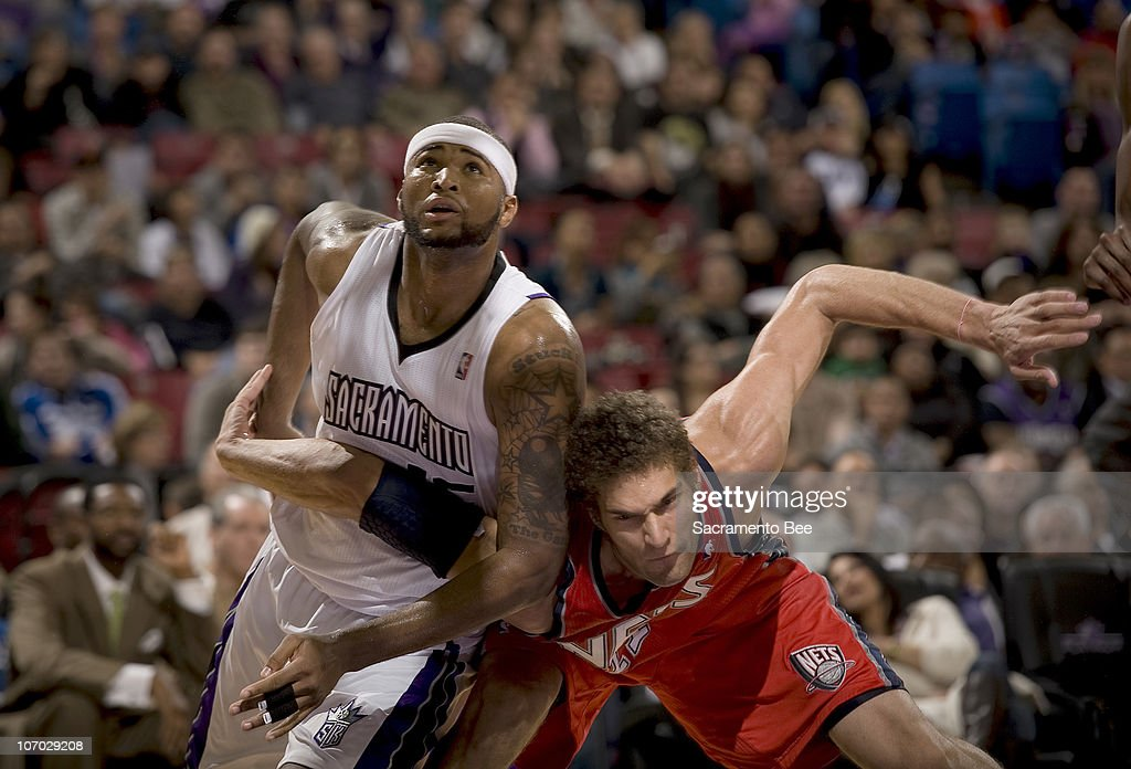 Sacramento Kings' DeMarcus Cousins, left, and New Jersey Nets' Brook Lopez battle for rebound position in the third quarter at Arco Arena in Sacramento, California, on Friday, November 19, 2010. The Kings slipped past the Nets, 86-81.