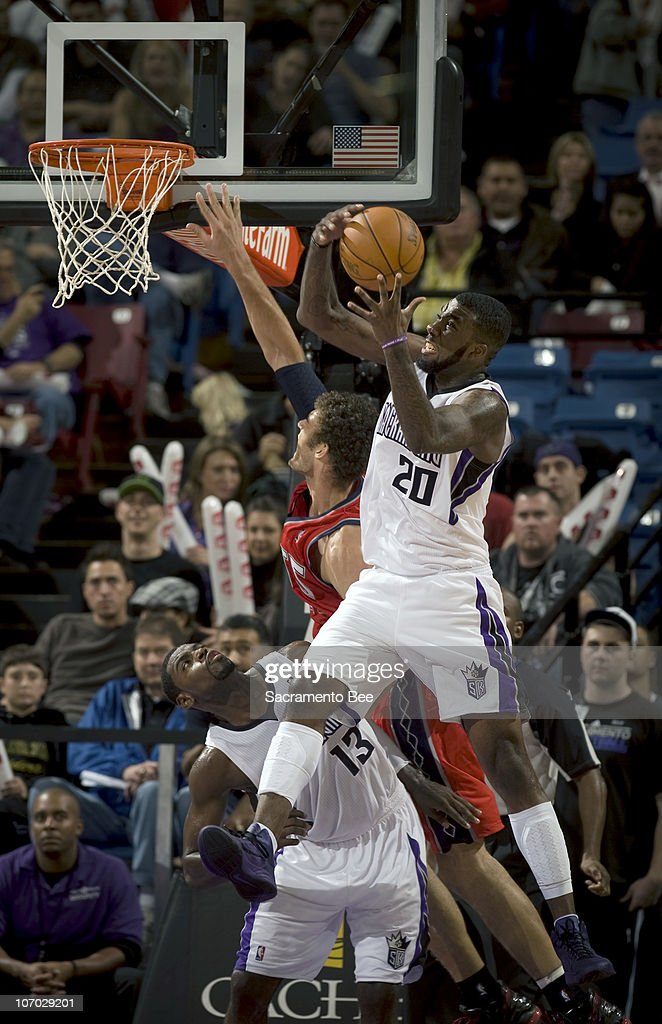 Sacramento Kings' Donte Green (20) goes hard to the rim over the New Jersey Nets' Brook Lopez in the fourth quarter at Arco Arena in Sacramento, California, on Friday, November 19, 2010. The Kings slipped past the Nets, 86-81.