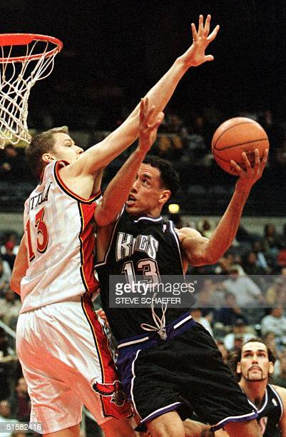 Sacramento Kings Doug Christie drives to the basket while being guarded by Atlanta Hawks Hanno Mottola during their game at the Philips Arena in...