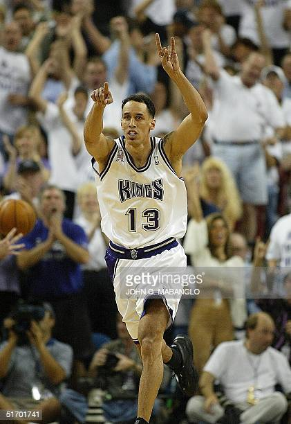 Sacramento Kings' forward Doug Christie points the crowd after sinking a three pointer against the Utah Jazz during the fourth period of game one of...