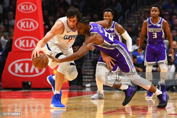 Sacramento Kings Forward Henry Giles III steals the ball from Los Angeles Clippers Center Boban Marjanovic during a NBA game between the Sacramento...