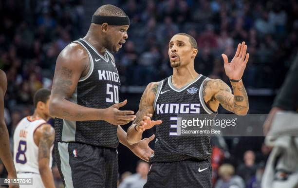 Sacramento Kings forward Zach Randolph and teammate Sacramento Kings guard George Hill talk as their team takes a commanding lede against the Phoenix...